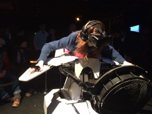 A Sundance festival-goer spreads her virtual wings with Birdly Max Rheiner's artfully customized flight simulator that creates the illusion that one is soaring over the cityscape of San Francisco.