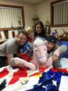 Horsing around on the set of The Bronze. From left to right, co-writer, Winston Rauch, co-writer and actress Melissa Rauch, producer Stephanie Langhoff, and director Bryan Buckley. Photo by Matt Lefebvre.