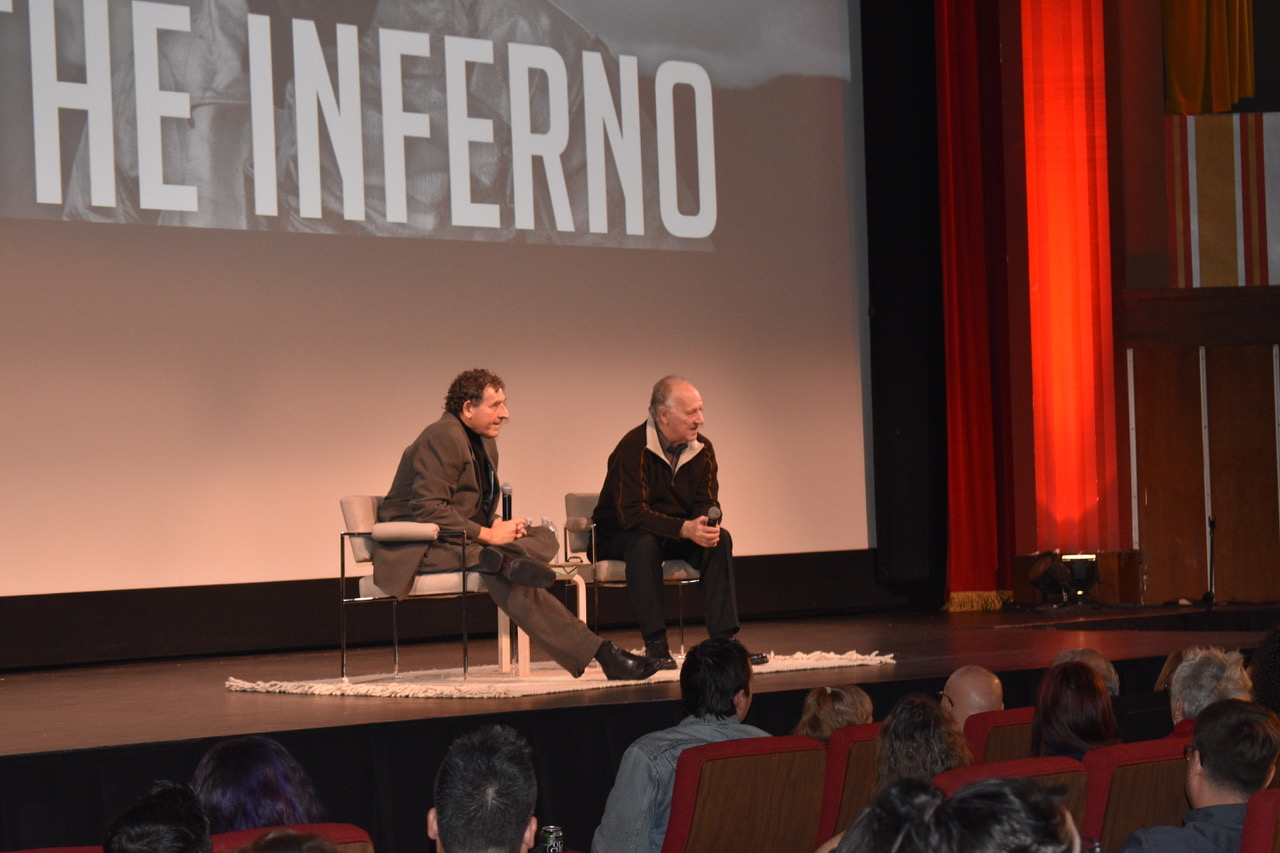 Title of The Inferno on the theater screen. Werner Herzog looking and answering questions from the audience.