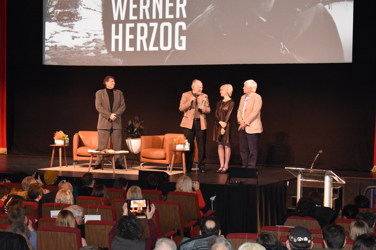 Inside Coolidge Corner Theater, Werner Herzog receiving award.