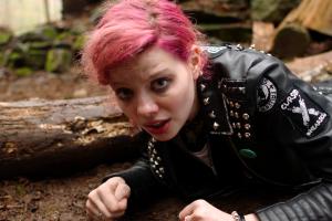 Chelsea (Chloe Levine) takes cover in The Ranger