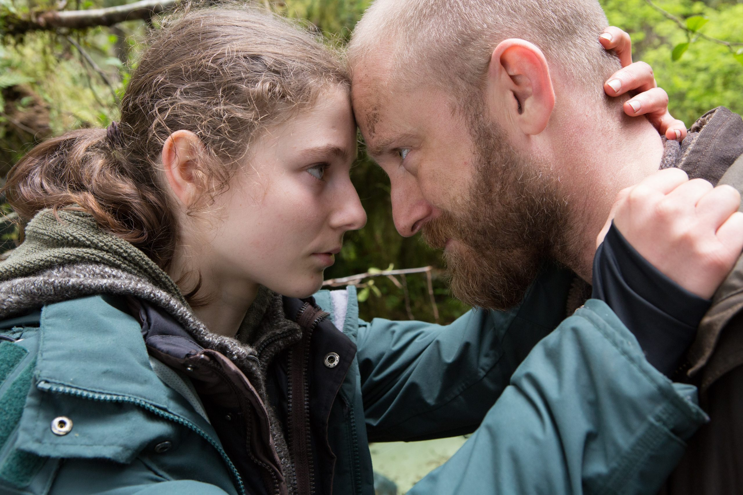 Thomasin McKenzie and Ben Foster put their heads together in Debra Granik's film Leave No Trace.