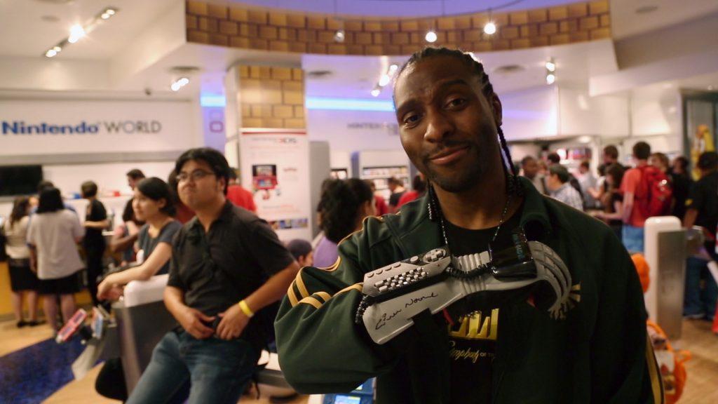 Man displays Mattel's Power Glove.