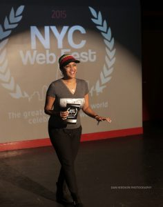 Woman greeting the crowd at the 2015 NYC Web Fest