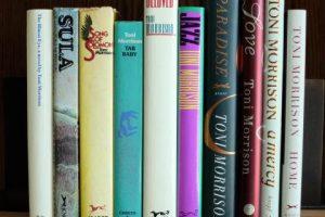 A still of 10 of Toni Morrison's novels sitting on a bookshelf side by side
