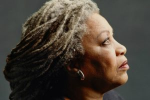 A profile shot of Toni Morrison with the back of her hair cast in shadow from the documentary Toni Morrison: The Pieces I Am