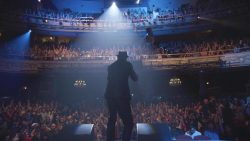 A performer under the spotlight at The Apollo Theater