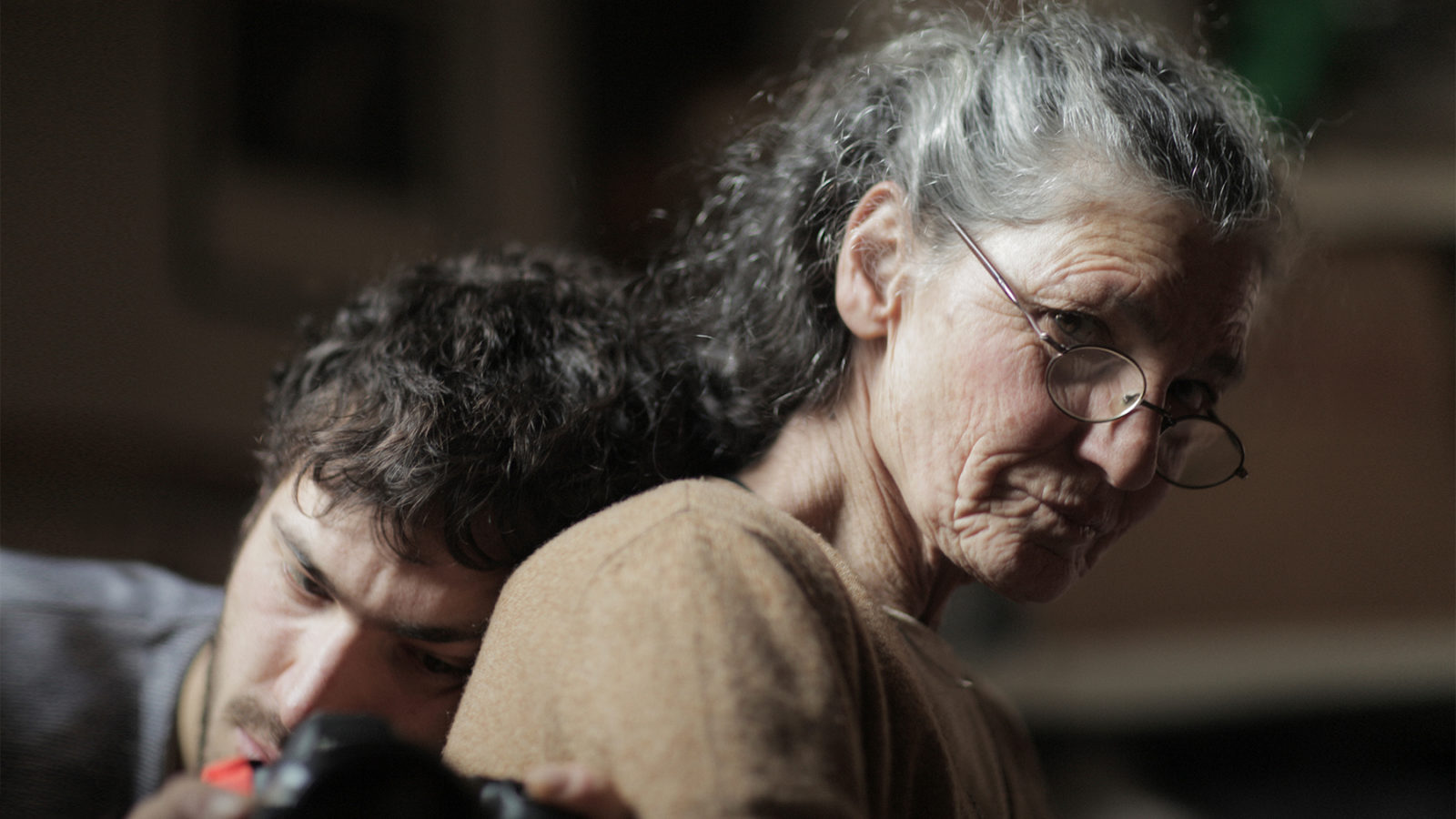 Beniamino Barrese rests his head on his mother Benedetta Barzini in his documentary The Disappearance of My Mother.
