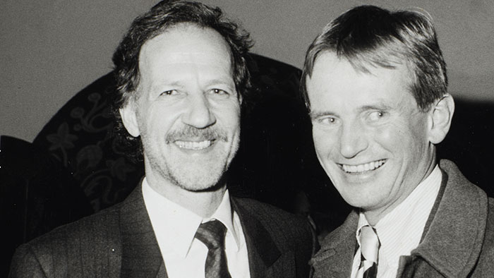 Werner Herzog stands smiling with his friend Bruce Chatwin in a black and white photo