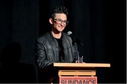 Director Sam Feder stands at a podium at the Sundance Film Festival