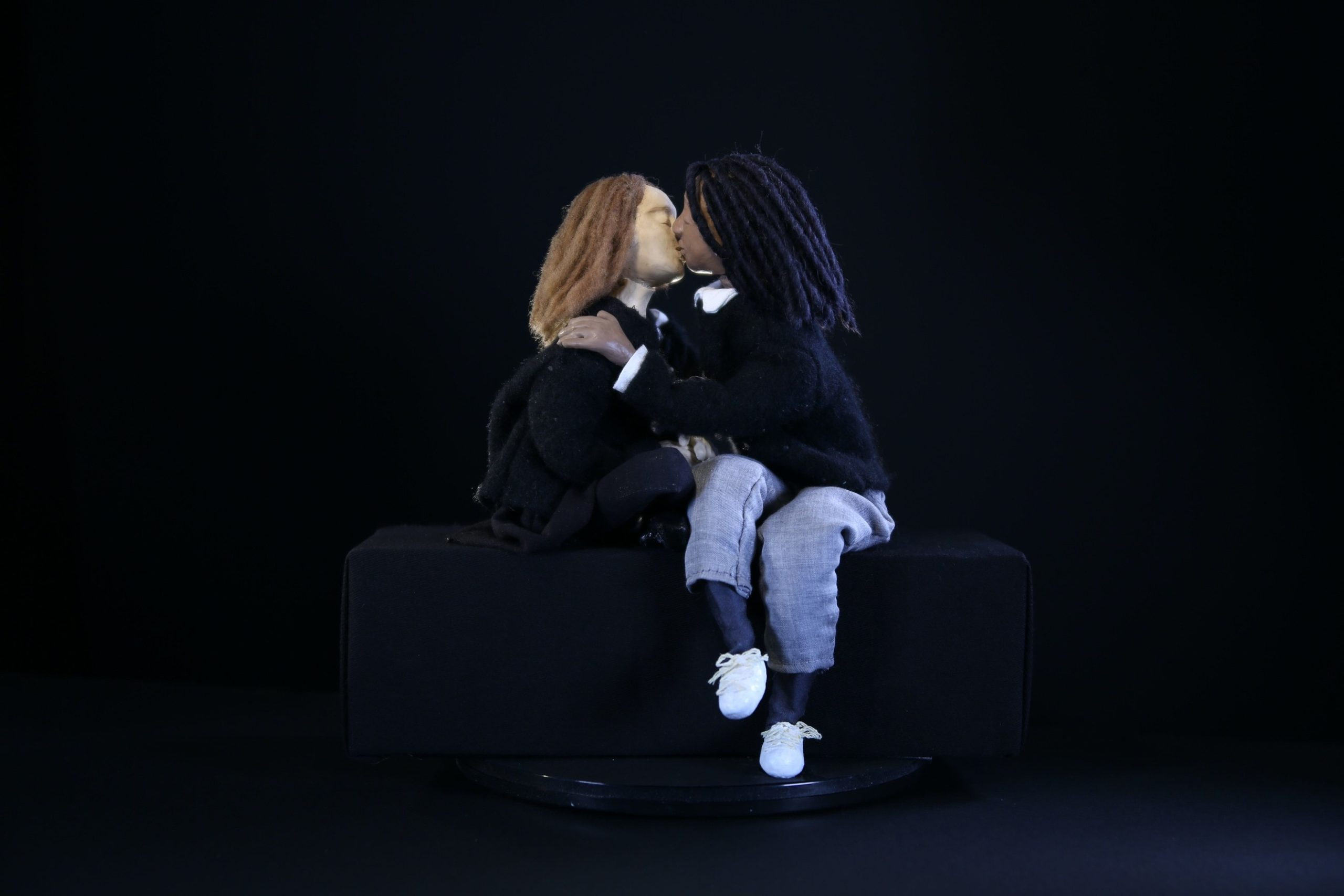 A shot of two puppets that represent the actors kissing in the film Tahara