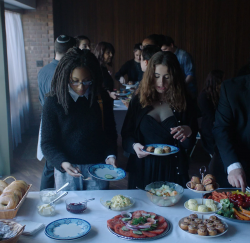 Carrie (Madeline Grey DeFreece) and Hannah (Rachel Sennott) grab some food together in the movie Tahara