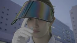 A woman lifting a visor with her glove in Maiko Endo's film Tokyo Telepath 2020