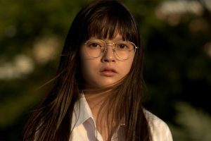 A still of a young Japanese girl with glasses and windswept hair from Maiko Endo's film Tokyo Telepath 2020