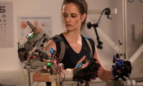 Eve Green as astronaut with Mechanical arm