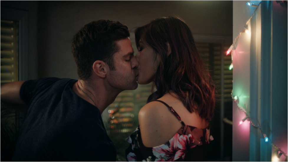 Belle and Austin sharing a kiss.