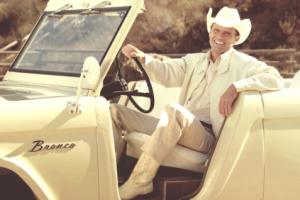 John Bronco (Walton Goggins) sitting in his jeep.