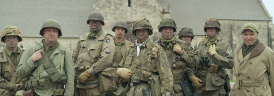 still of actors in fatigues as soldiers at Normandy