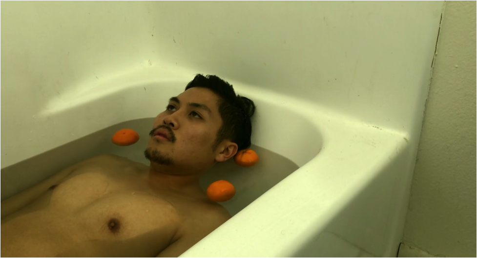Balka floating in tub with oranges.