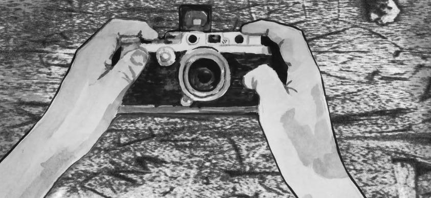 illustration of camera in hands.