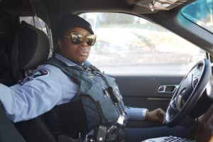 Black policewoman in car
