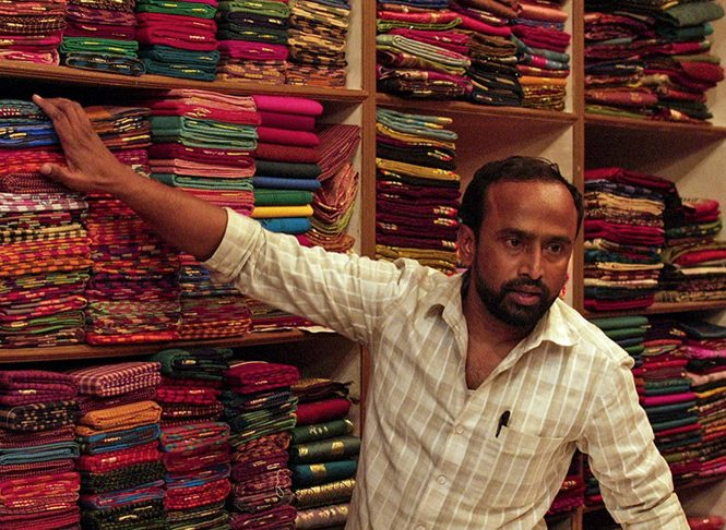 Husband with fabric in his shop