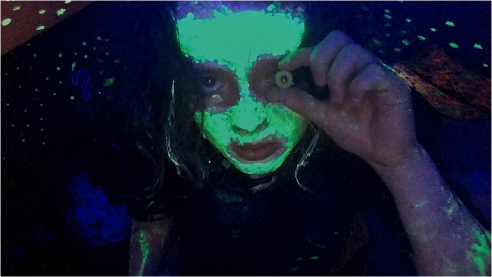 Photo of woman with glow-in-the-dark paint.