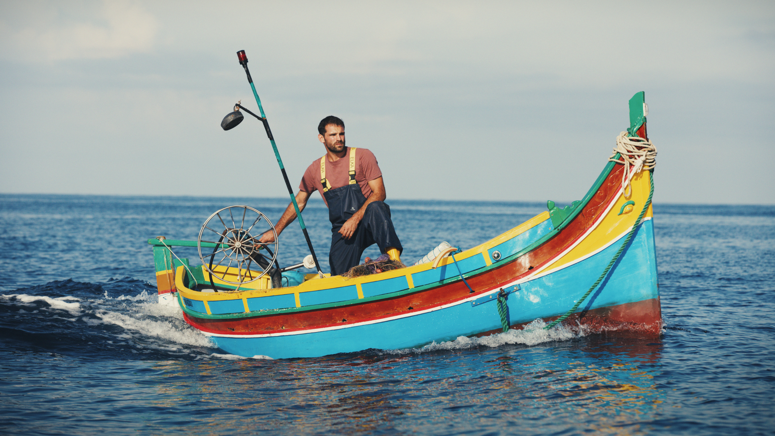 Fisherman in boat.