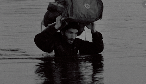 Man carrying package in water