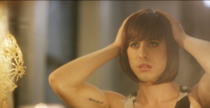 A young transgender woman wearing a wig.