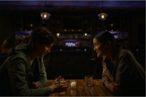 Two women sitting at a restaurant.