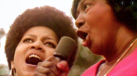 Mahalia Jackson and Mavis Staples singing together.