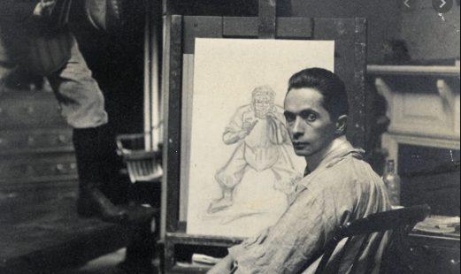J.C. Lyendecker in front of drawing board.
