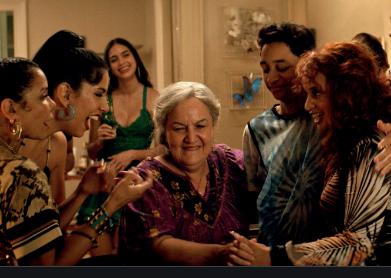 Family celibrating their abuela.