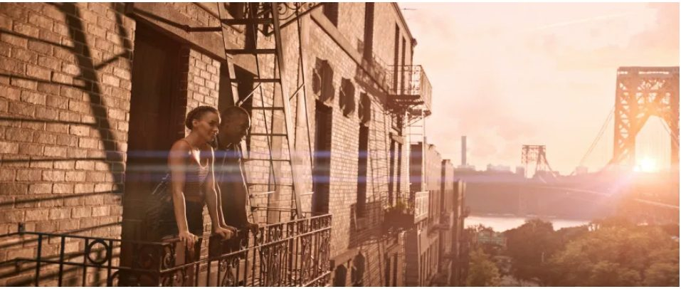 A man and woman on a fire escapte staring out at morning in New York City.
