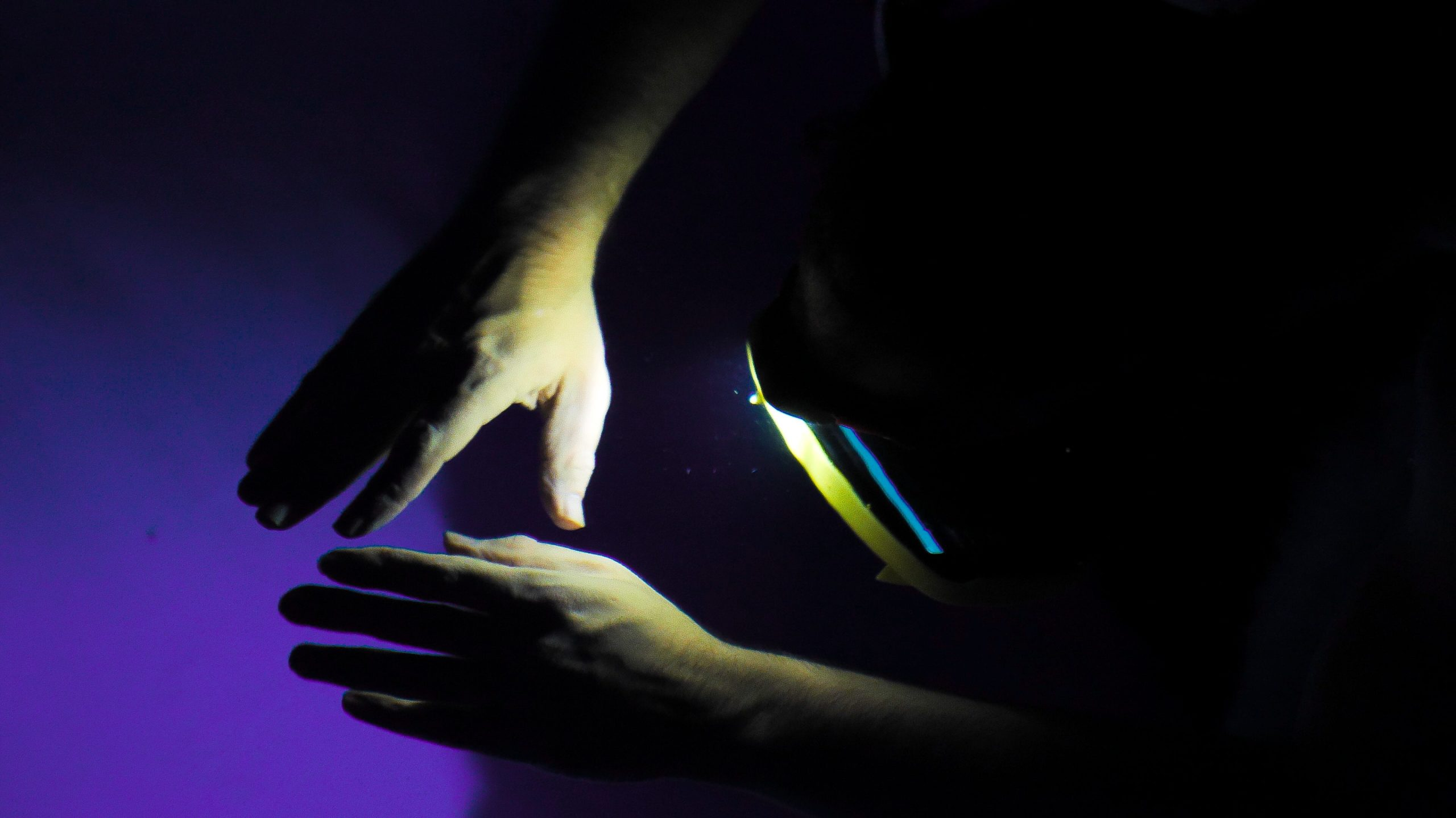 Close up of hands of viewer in SPACED OUT experience.