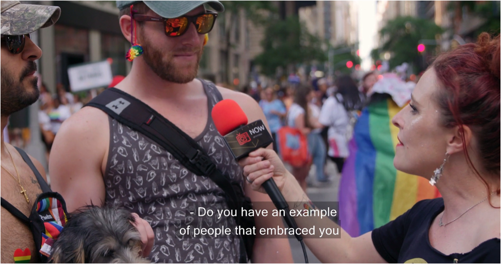 """Fiona Dawson asking person on street, """"Do you have an example of people that embraced you?"""""""