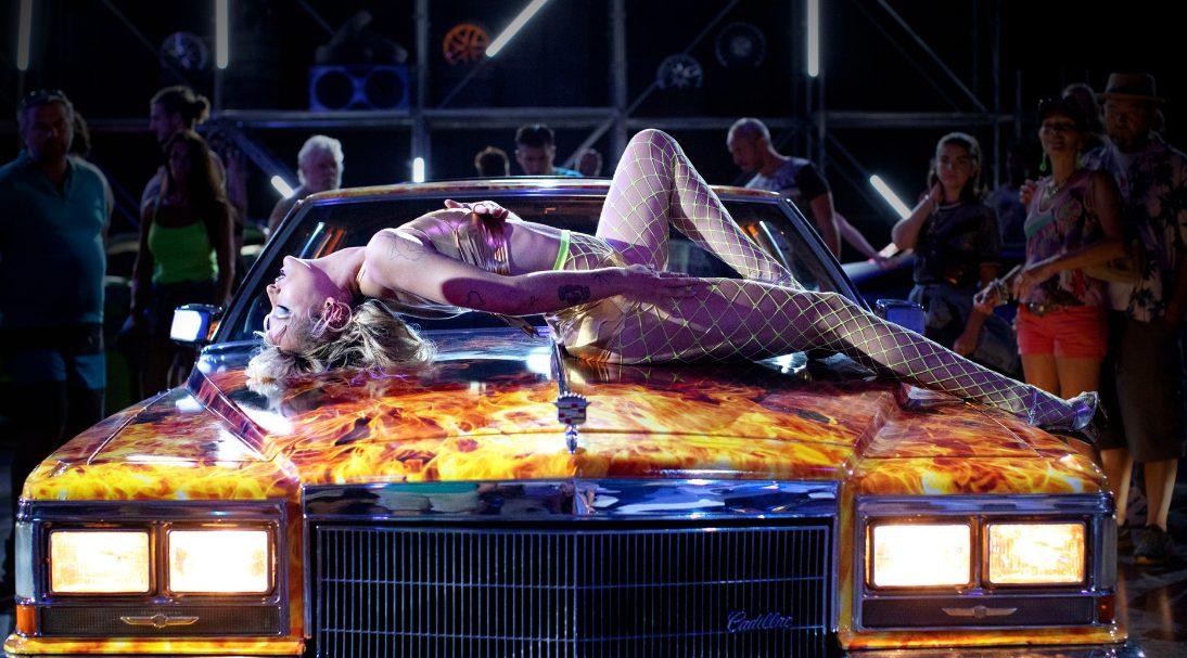 Woman on car.